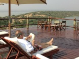Marc reading on pool deck, Mweya Safari Lodge, Queen Elizabeth NP
