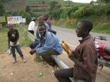 Young man selling roasted corn during vista stop, road to Lake Bunyonyi