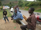 Young man selling roasted corn during vista stop, road to Lake Bunyonyi