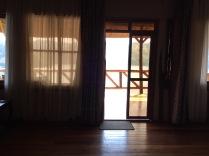View from beds, looking toward porch, Crater Safari Lodge, Lake Nyinabulitwa