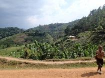 Girl running, road to Bwindi