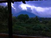 View of Mount Sabyinyo, extinct volcano, from porch of main pavilion, Mountain Gorilla View Lodge, Kinigi