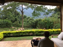 Marc relaxing in open-air lounge after arriving at Sanctuary Gorilla Forest Camp, Bwindi Impenetrable NP
