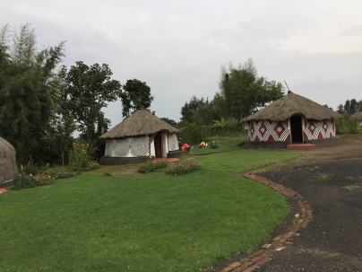 Traditional dwellings, Iby'Iwacu Cultural Village, Kinigi. The poles atop the dwellings signify that a man heads the household.