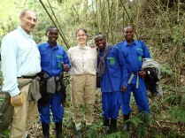 Marc, Gini and porters, start of gorilla trek, Volcanoes NP. Emmy, to my left, was my porter, and he was wonderful — always there with a firm clasp of my hand when the going got tricky.