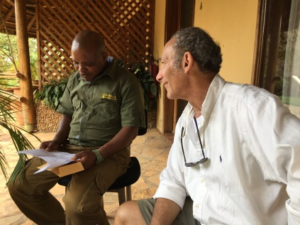 Kenneth and Marc relaxing on patio after grueling drive from Crater Lake Safari Lodge to Le Petit Village, Kampala