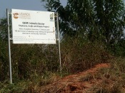 Sign near trench to prevent elephants from damaging crops, road to Queen Elizabeth NP