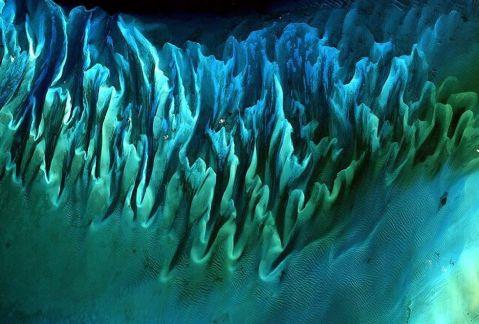 Ocean sand, Bahamas, 2001 / NASA / Click for more.